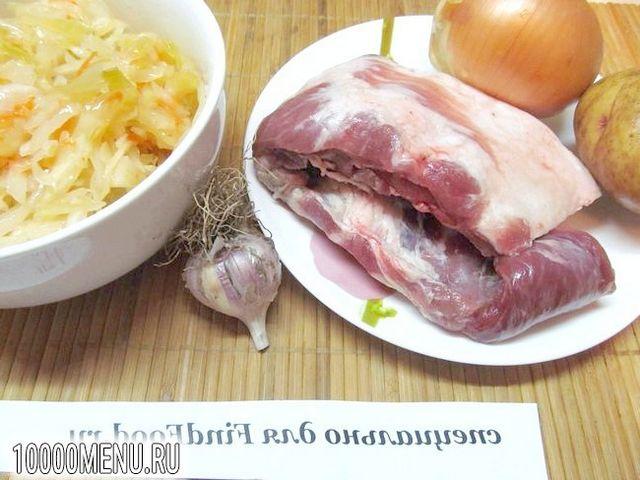 Фото - Свинячі реберця з кислою капустою в мультиварці - фото 1 кроку